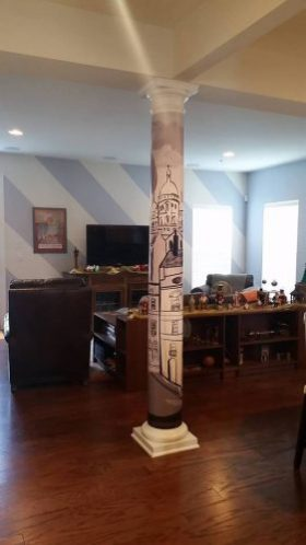 Mickey R used a wall mural to wrap a column in the center of his living room