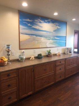 A beach & tropical mural warms up an Alaskan kitchen.