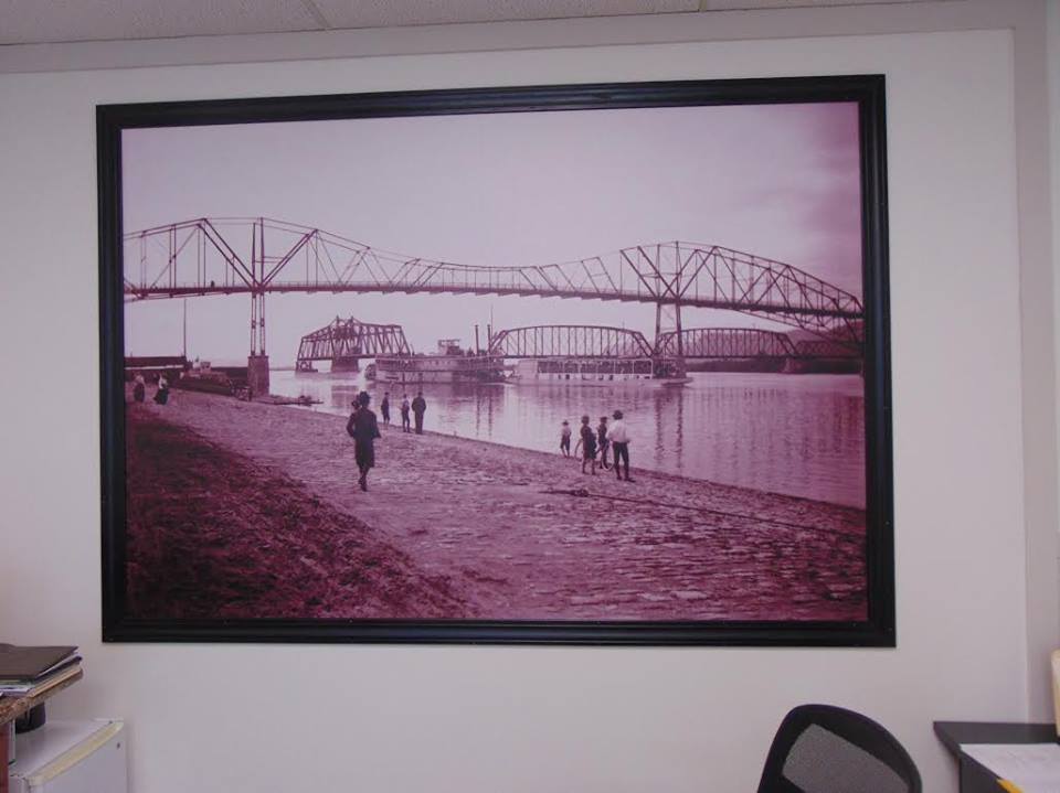 A custom wallpaper wall mural made with a vintage image from the local historical society.