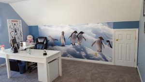 A photographic wall mural can add a lot of visual space to an otherwise small room. And who doesn't love penguins?