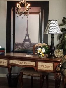 Sometimes an accent wall doesn't have to be a whole wall. This Eiffel Window mural certainly gives this home office a French accent.