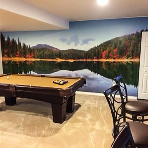 By not having any furniture directly in front of this Autumn Mountain Lake mural, it makes it seem as if you could take a dip in between shots.