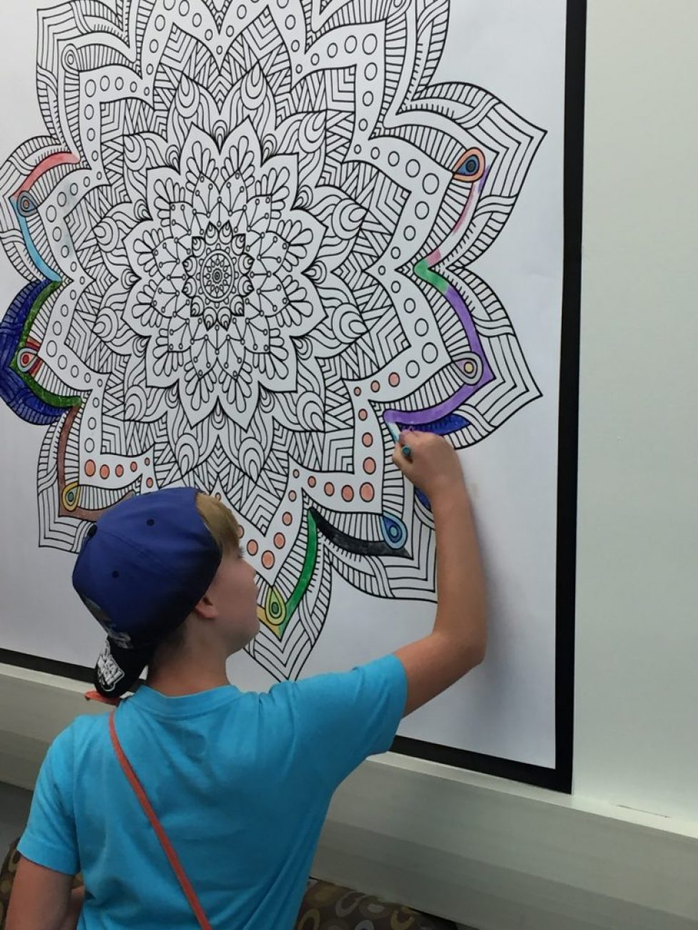 A student colors a Magic Murals' ColorMe mural in the MakerSpace at Delaware Valley Friends School in Pennsylvania.