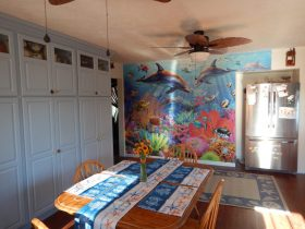Dolphin Coral Reef wall mural in beachy kitchen - Magic Murals