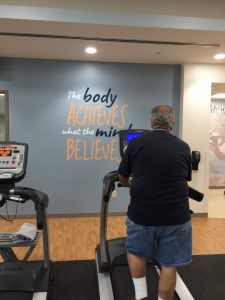 Motivational messages at Johnston Health's Cardiopulmonary Rehabilitation center get patients to walk that extra mile toward better health. Photo by MagicMurals.com