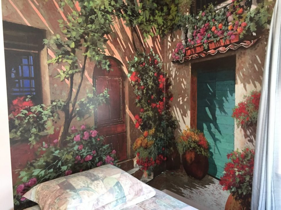 Colorful Italian Wall Mural Creates 3D Effect