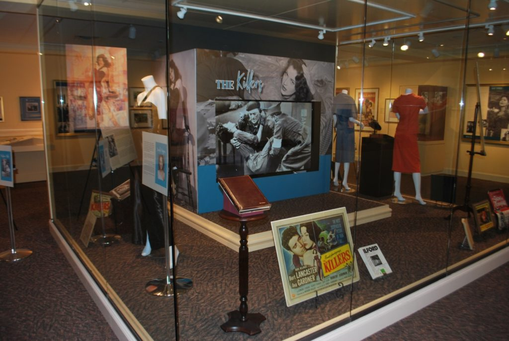 Adhesive graphics cover the video monitor in the main display case at the Ava Gardner Museum.