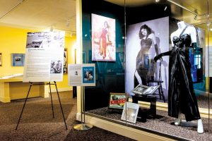 "Photo backdrops for ""The Killers"" fashion display at the Ava Gardner Museum."