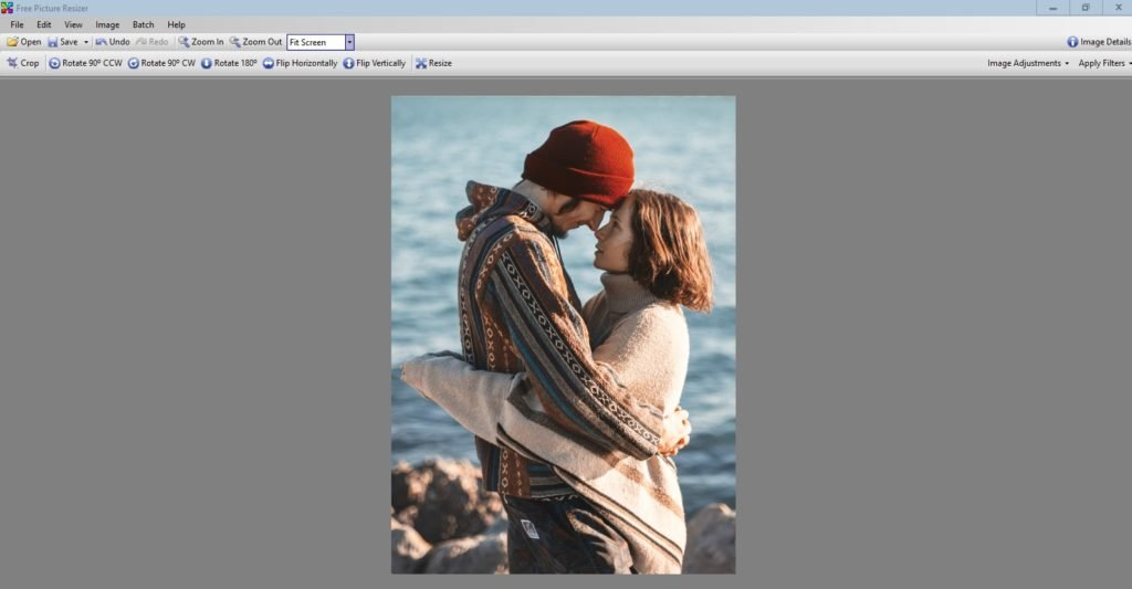 Solution: Crop the photo to focus on the beautiful couple and create a wallpaper mural in a different size.