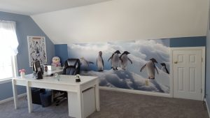 It's your home office, so decorate it to inspire you. A fun wall mural like this in the background will serve as a great ice breaker. Get it? Ice breaker. Penguins. We just couldn't help that pun from coming out. Mural by Magic Murals.