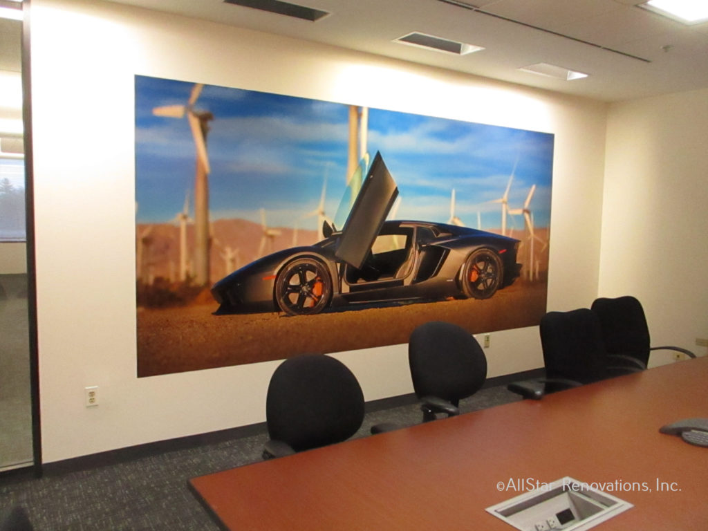 Wall murals can help to create a desired atmosphere in your conference room amongst all of your employees. As an added bonus, they serve as a great background for video calls & conferences. Courtesy of All Star Renovations. Mural by Magic Murals.