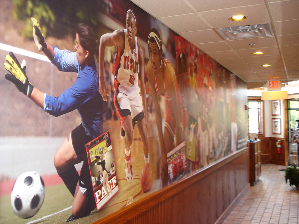 Whether there's a game on or not, everyone who roots for the local teams does so at Raleigh's Backyard Bistro, featuring this wall mural celebrating local college sports.