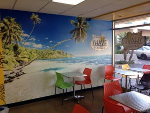 A tropical wall mural at Brian's Shave Ice in Northridge, California lets passers by know this is a fun establishment that cares about the customer experience.