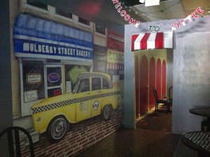 """Magic Murals' """"NYC Taxi"""" mural in the New York 2 Chicago Pizzeria in Kent, Ohio."""