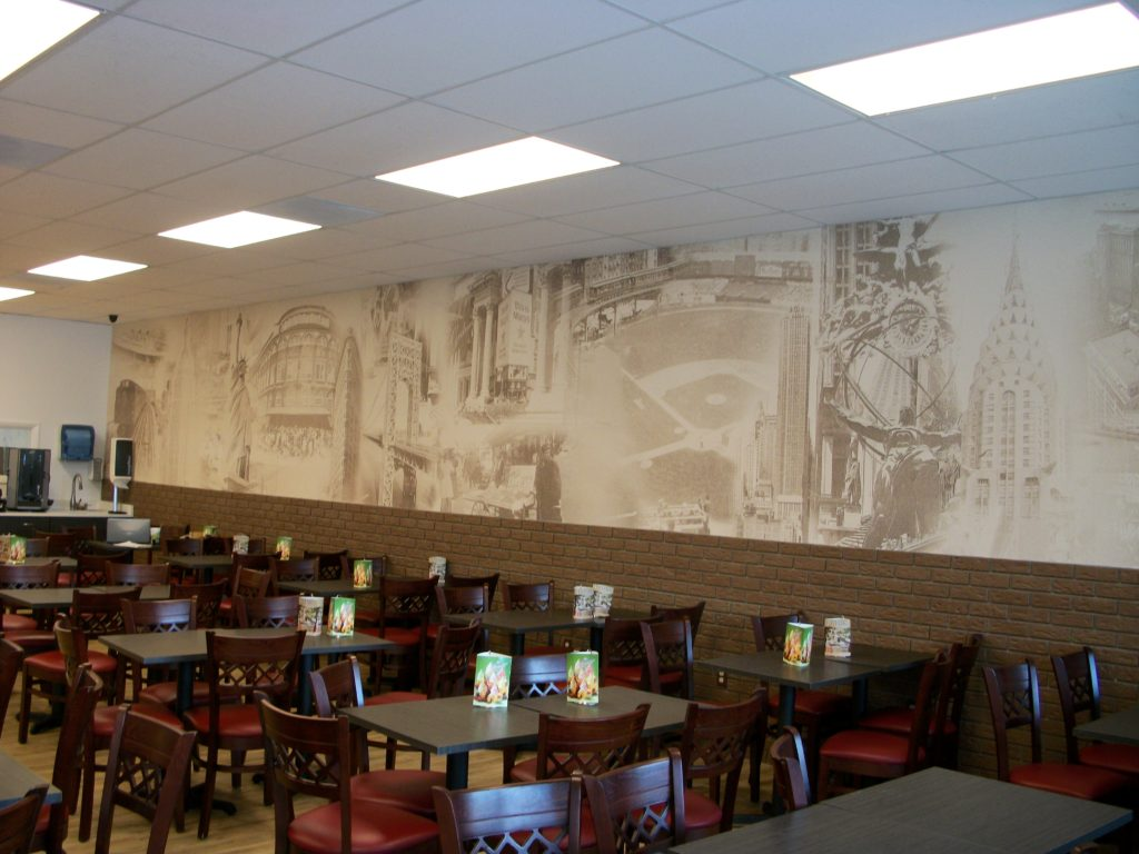 Goldberg's New York Bagels celebrates their Big Apple heritage and authenticity with a vintage NYC wall mural.