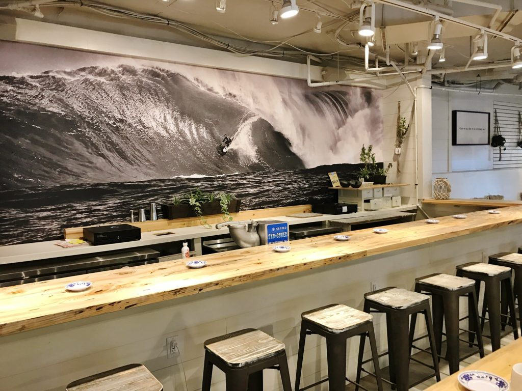 A classic black & white beach mural behind the service counter at the Hideaway Restaurant in Bethany Beach, DE. Design & Photograph by Marnie Oursler.