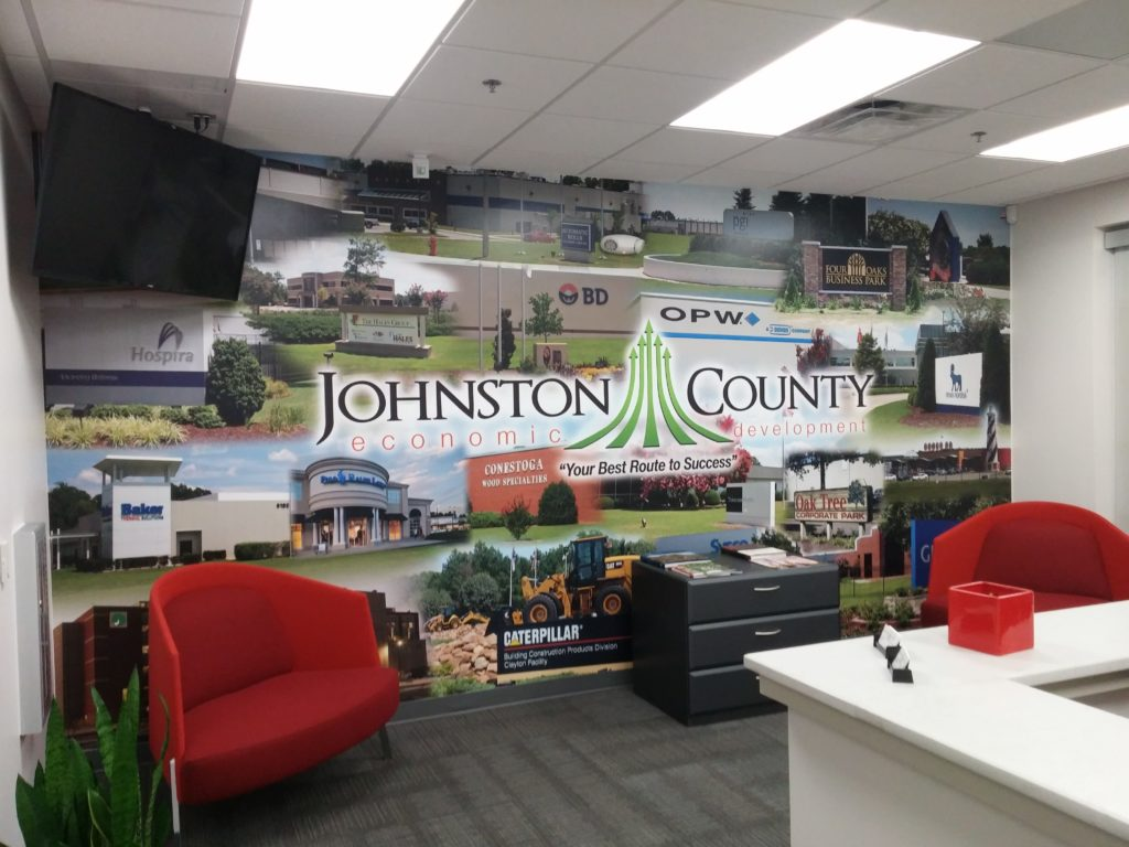 As business trips get cancelled and rescheduled as video calls, a backdrop like this can tell your story without you having to say a word. Thanks to Johnston County Economic Development. Mural by Magic Murals.