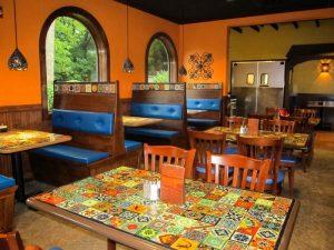 Mi Pueblita tabletops covered with custom talavera tile murals