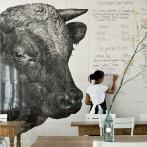 Speaking of laminates, dry erase laminate can be used to create a bright and clean version of the every-changing chalkboard menus that are popular in many farm-to-table venues. For a fraction of the price of the custom tile shown here at Côté Maison in Cannes, France, you can have a similar look.