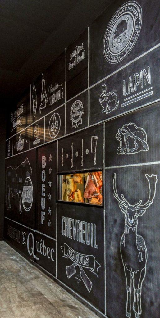 Chalkboard wall mural in restaurant O Chevreuil in Sherbrooke, Quebec, Canada.