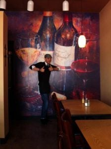 We grabbed this shot right off of social media. Cristo's Pizza has nailed how to provide the perfect selfie background with this wine bottle wall mural. We wouldn't be surprised if it increases bottle sales too!