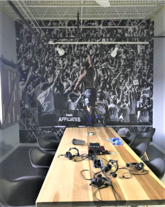 At Cross Fit Mayhem in Cookeville, TN, Rich Froning & Friends record all of their podcasts in this room that's been decked out for maximum brand building. Mural by Magic Murals.