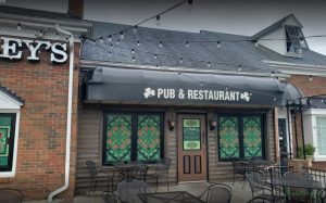 Perforated window film murals give O'Malley's Pub an authentic Irish feel. While allowing patrons inside to still see outside, they also cut the glare of the setting sun every day.