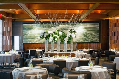 A wall mural featuring rushing ocean waters gives a fresh feel to Le Barnadin's fine dining.