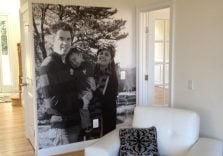 black and white family photo mural in famil room living room 224x156