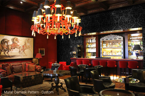plus lounge bar with red wall and black and red leather seating and damask wallpaper with a speakeasy vibe