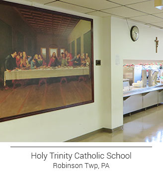 Holy Trinity Catholic School's The Last Supper image in cafeteria trimmed with wood frame