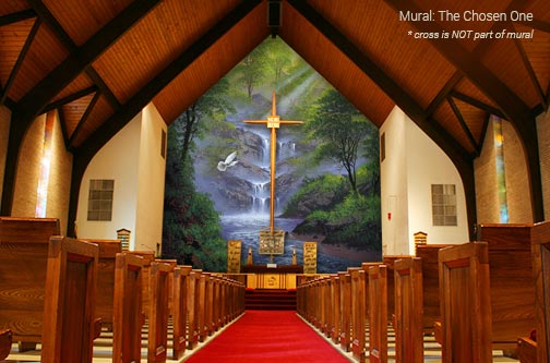 painting of waterfall landscape backdrop for pulpit at the front of church