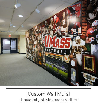 colorful UMass Football collage mural on long hallway