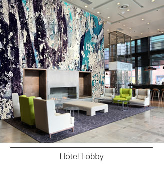 large scale abstract textured blue white and navy wall mural in a modern hotel lobby