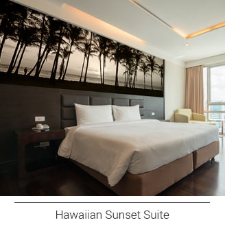 hotel room décor with a horizontally oriented grayscale panoramic beach and palm tree mural
