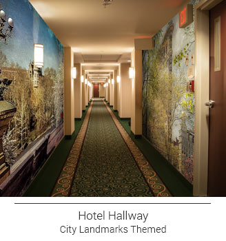 themed hotel hallway featuring artist city landmark murals