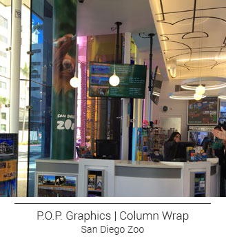 San Diego checkout counter column wrap with photo of upside down hanging orangutan with green foliage backdrop