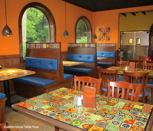 custom table top and booth murals in a restaurant designed to mimic real ceramic tiles