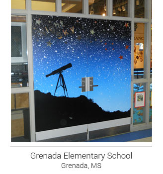creatively themed door mural inspiring minds in Grenada Elementary School, Explore the Heavens, silhouette of the night sky, telescope and stars