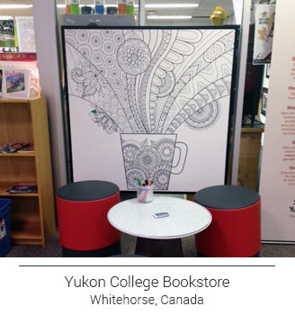 coffee mug doodle ColorMe! mural in the Yukon College Bookstore in Whitehorse Canada accented by comfy red sitting stools